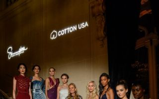 US ambassador Jane Hartley, hosting the Paris Supima/Cotton USA fashion show, surrounded by models in haute couture gowns made from the finest US c...