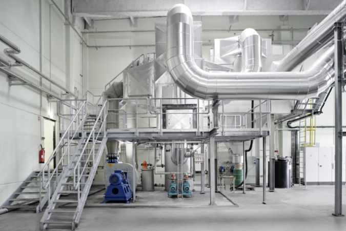 A flue gas scrubber cleans the flue gases from the recycled,oil-fired boiler