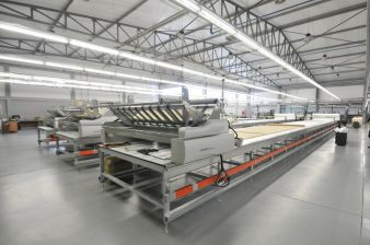 A total of three spreaders ensure tension free laying of all kinds of material for men, women and children's wear made by N.S.T. Portugal