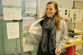 Project team member Susanne Aumann presents the stab protection cardigan in the laboratory at the Research Institute for Textiles and Clothing Phot...